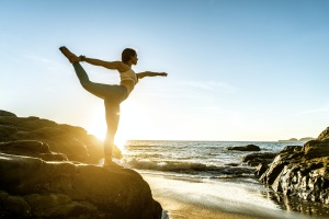 women learning the health benefits of yoga