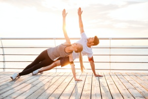 couple working on yoga poses for stress