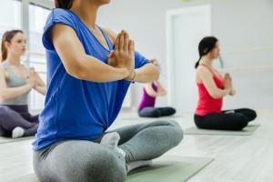 women doing yoga poses for stress