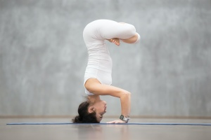 women learning How to Do Headstand