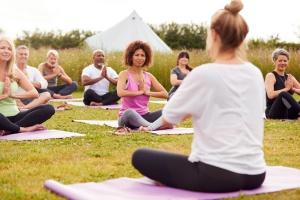 women Teaching Yoga outside