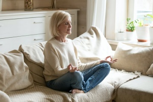 older women doing a at home yoga sequence