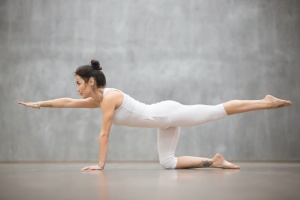 girl in white doing yoga practicing her verbal cues
