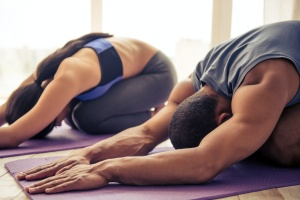 couple finding stress management in yoga