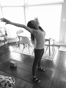 black and white image on woman at home on yoga mat
