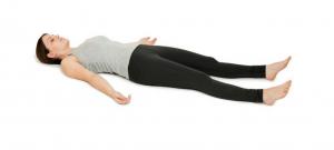 women laying on white background showing yoga pose