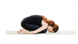 women demonstrating pose with her forehead resting on floor