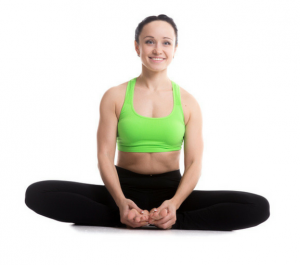 women smiling while doing yoga pose in green top