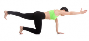 women who is holding one arm pose in a green top learning yoga poses for core strength