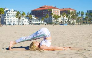 women on the beach holding a back bend fold
