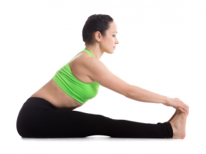 women reaching her toes and holding them for a pose