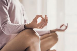 close up of women who is practicing yoga's fingers