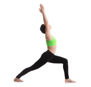 women in green top showing how to do lunge pose