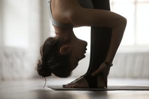 women doing a folded yin yoga pose