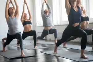 class practicing yin yoga
