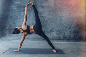 women doing difference between yin and restorative yoga