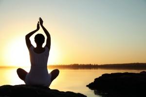 girl doing sraddha yoga in sunset