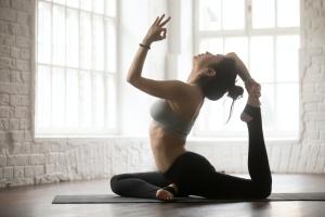 women inside doing 200-Hour Yoga Teacher Training