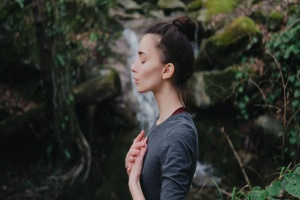 women doing breathing to Reduce Anxiety